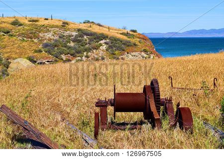 Rustic historical farm equipment taken on grasslands at Santa Cruz Island, CA in Channel Islands National Park