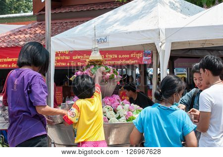 PHITSANULOK THAILAND - April 12 2016: Thai people celebrate Songkran Festival by pouring water over Buddha statue or pray on April 12 2016 in Phitsanulok Thailand.