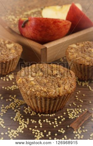 Fresh muffins with millet groats oatmeal flakes cinnamon and apple baked with wholemeal flour concept of delicious healthy dessert or snack
