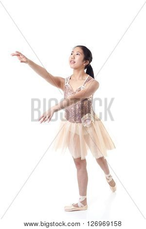 Young Ballerina Executing A Ballet Pointe Movement