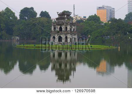 Early evening on lake Hoan Kiem. View of the turtle tower, Hanoi, Vietnam