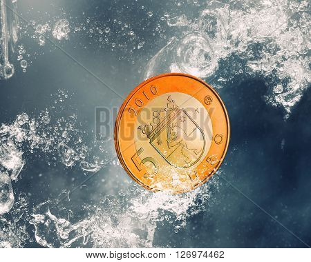 Coin sink in water