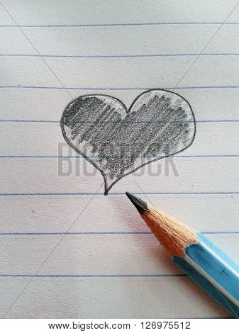 Heart drawing and pencil on white paper