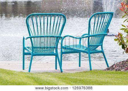 Two Blue Chairs At The Waterfront