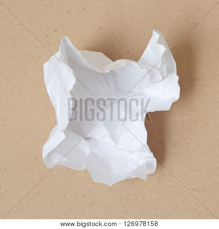 open Crumpled paper ball on wood background