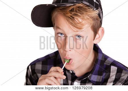 Handsome Young Boy Enjoying A Lollipop