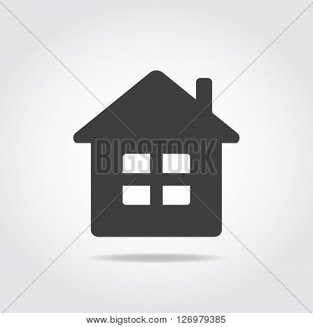 Simple black icon. House with windows and chimney.