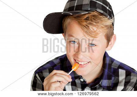 Cute Young Boy Eating A Lollipop