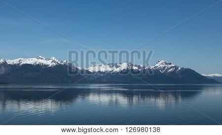 The mountainous coastline of Alaska's Inside Passage near Glacier Bay