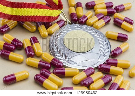 Doping in sport concept, blood-stained gold medal