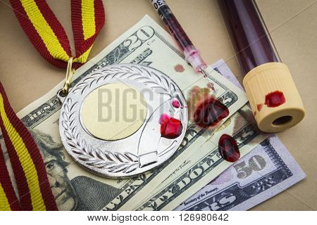 Doping in sport concept, along with a syringe blood money