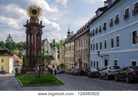 Banska Stiavnica, Slovakia - May 4, 2013: View of Column of the Virgin Mary and the Holy Trinity located on Holy Trinity Square in Banska Stiavnica town Slovakia. Banska Stiavnica is historic medieval town inscribed in UNESCO heritage list.
