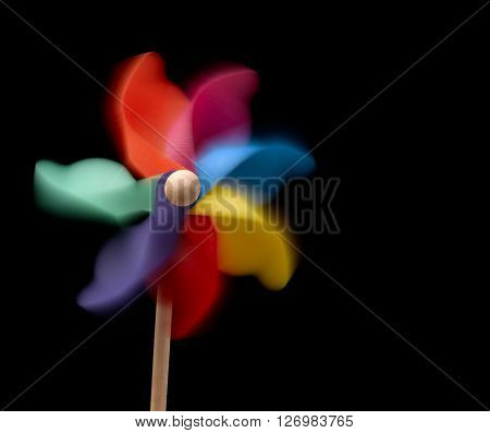 Pinwheel isolated on a black background with movement
