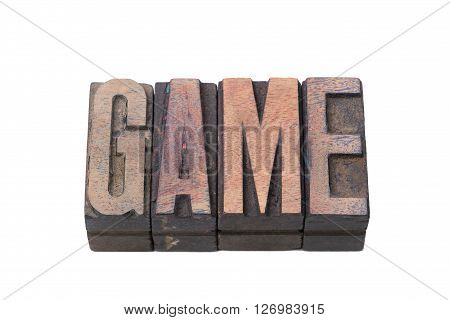 game word made from vintage wooden letterpress type isolated on white