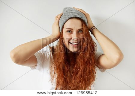 Beautiful Cheerful Young Woman With Healthy Freckled Skin Looking And Smiling At The Camera. Isolate