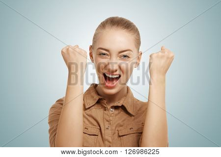 Close Up Isolated Portrait Of Ecstatic Caucasian Young Female Screaming And Holding Fists In Winning
