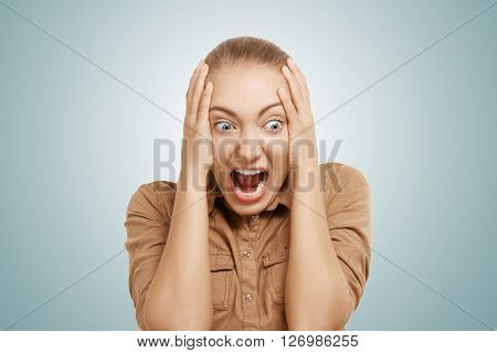Close Up Shot Of Stressed And Shocked Young Blonde Businesswoman Screaming With Desperate And Horrif