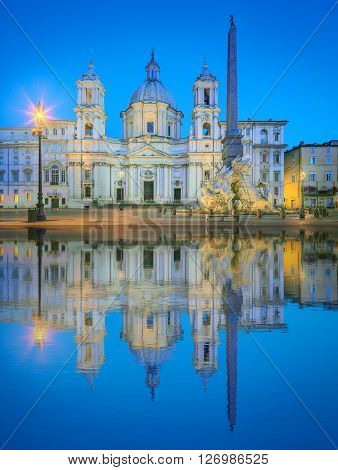 Fountain of the Four Rivers, Piazza Navona Fontana di Quattro Fiume and church Sant'Agnese in Agone, Rome, Italy.