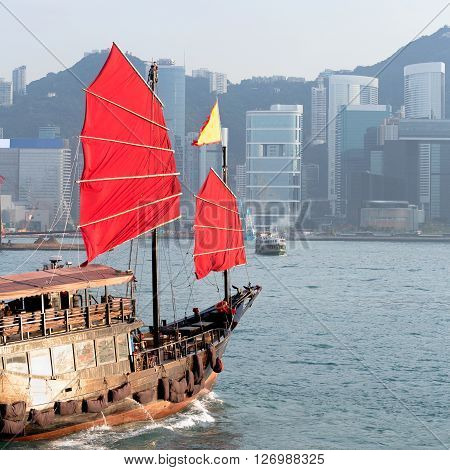 Duk Ling Ride Hong Kong harbour with tourist junk