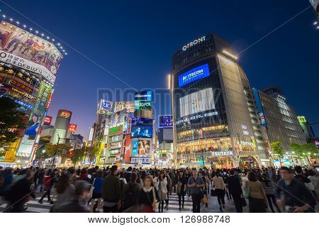 Tokyo, Japan - November 6, 2015: Pedestrians cross at Shibuya Crossing on November 6th in Tokyo, Japan, 2015 . Shibuya Crossing is one of the busiest crosswalks in the world.