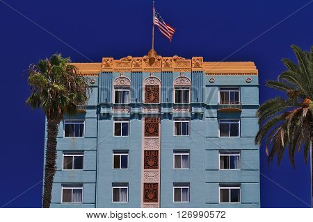 a picture of an exterior 1920's era apartment building