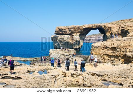 GOZO ISLAND, MALTESE ISLAND - NOVEMBER 5, 2015. People take photos of Azure Window, one of the most beautiful attraction of Gozo Island .