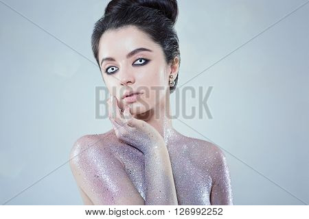 Potrtait of woman with beautiful creative fashion makeup