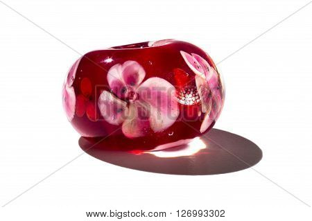 Hand made red with flowers glass bead on white background