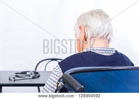 Photo of elderly woman waiting for the doctor