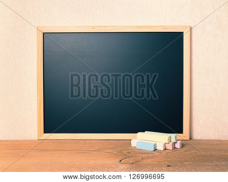 Empty Blank School Black Board With Colorful Chalks On Wooden Background, Close Up