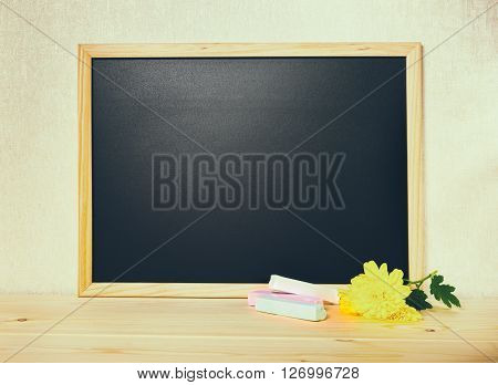 Empty Blank School Black Board With White Chalks And Chrysanthemum Flower On Wooden Background, Tone