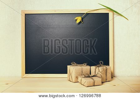 Concept Of School Is Over, Happy Holidays, Blank School New Black Board With Tulip And Gift Boxes, C