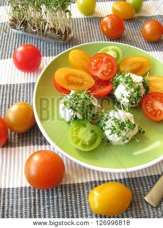 Cream cheese balls with cress and tomatoes