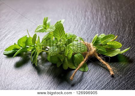 Beautiful Bunch Fresh Green Mint Tied Twine On Slate Background, Close Up
