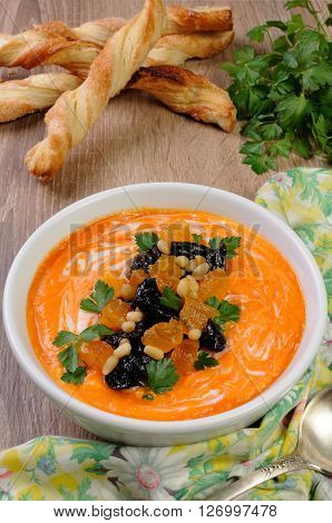 Sweet pumpkin puree soup with dried apricots prunes pine nuts