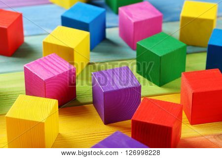 Colorful Wooden Toy Cubes On A Colorful Wooden Background
