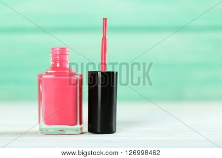 Bottle Of Nail Polish On A Wooden Table