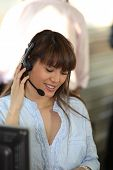 image of telemarketing  - Portrait of a smiling telemarketer - JPG