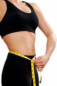 picture of tape-measure  - woman in black training gear with a tape measure - JPG