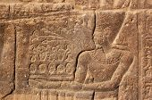 stock photo of isis  - Carving of an ancient Egyptian Pharoah offering food and ducks to the Gods - JPG