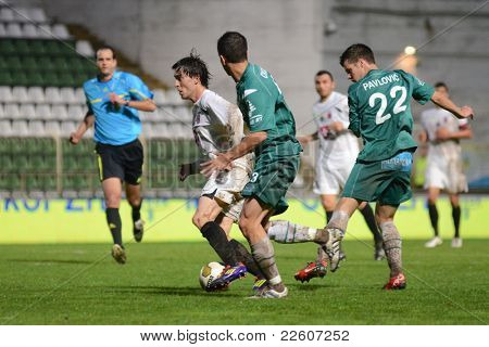 KAPOSVAR, HUNGARY - JULY 30: Bojan Pavlovic (in green 22) in action at a Hungarian National Championship soccer game - Kaposvar (green) vs Videoton (white) on July 30, 2011 in Kaposvar, Hungary.