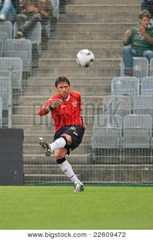 VIENNA,  AUSTRIA - JULY 26: Diego Alves Carreira (#1, Valencia) kicks the ball during the friendly soccer game on July 26, 2011 in Vienna, Austria. SK Rapid wins 4:1.