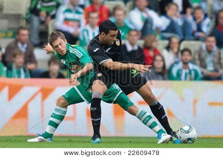 VIENNA,  AUSTRIA - JULY 26: Adil Rami (#4, Valencia) and Deni Alar (#33, Rapid) fight for the ball during the friendly soccer game on July 26, 2011 in Vienna, Austria. SK Rapid wins 4:1.