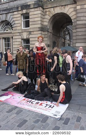 EDINBURGH - AUGUST 14 : Members of Cambridge University Amateur Dramatic Club pose for photos on Royal Mile during Edinburgh Fringe Festival on August 14, 2011 in Edinburgh