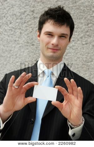 Businessman Holds A Blank Card - Add Your Own Text.