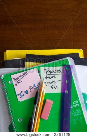 School Book And Supplies On Desk