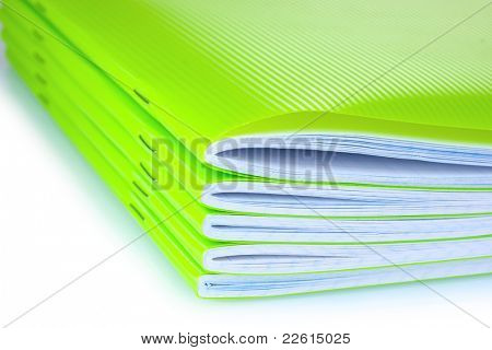 green notebook isolated on white
