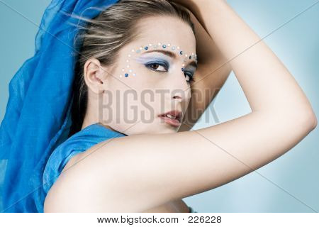Attractive Young Model With Gems And Makeup