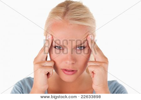 Blond woman with a headache in a studio