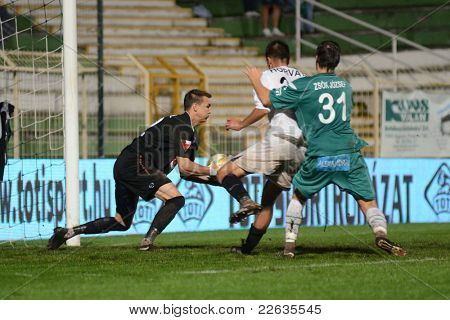 KAPOSVAR, HUNGARY - JULY 30: Tomas Tujvel (in black) in action at a Hungarian National Championship soccer game - Kaposvar (green) vs Videoton (white) on July 30, 2011 in Kaposvar, Hungary.